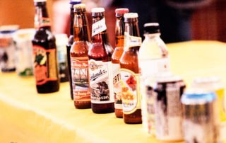 Line of beer bottles on a table at the first member meeting